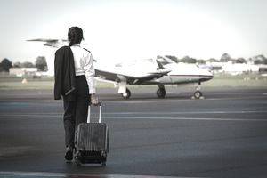 Pilot walking to a private corporate jet