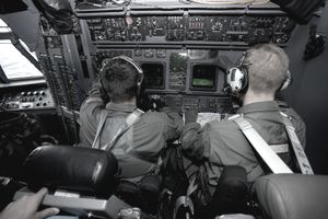 Airmen at work in a MC-130H Combat Talon II