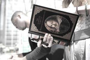 """woman holding """"the complete works of william shakespeare"""" to represent literary themes."""
