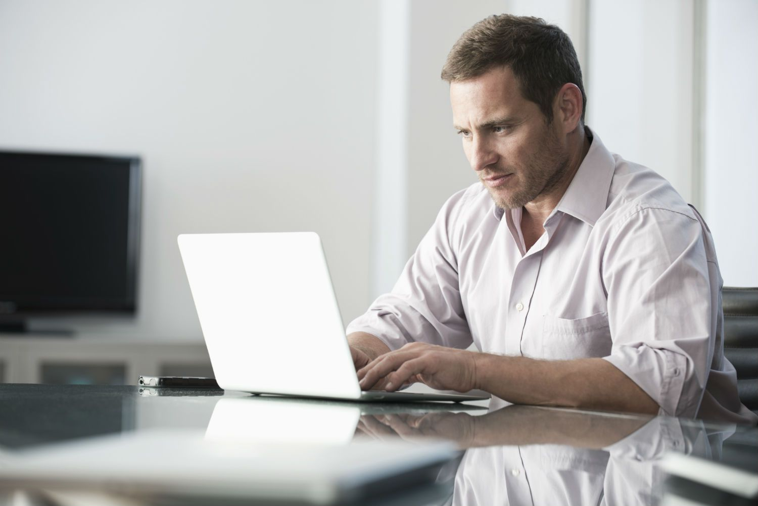 Man working online at a laptop