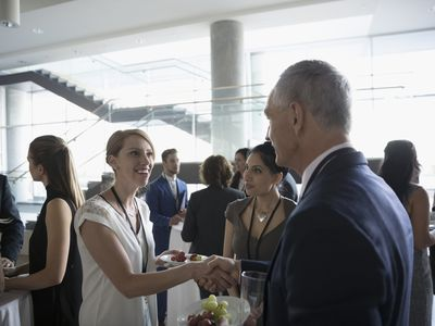 Woman shaking hands with businessman