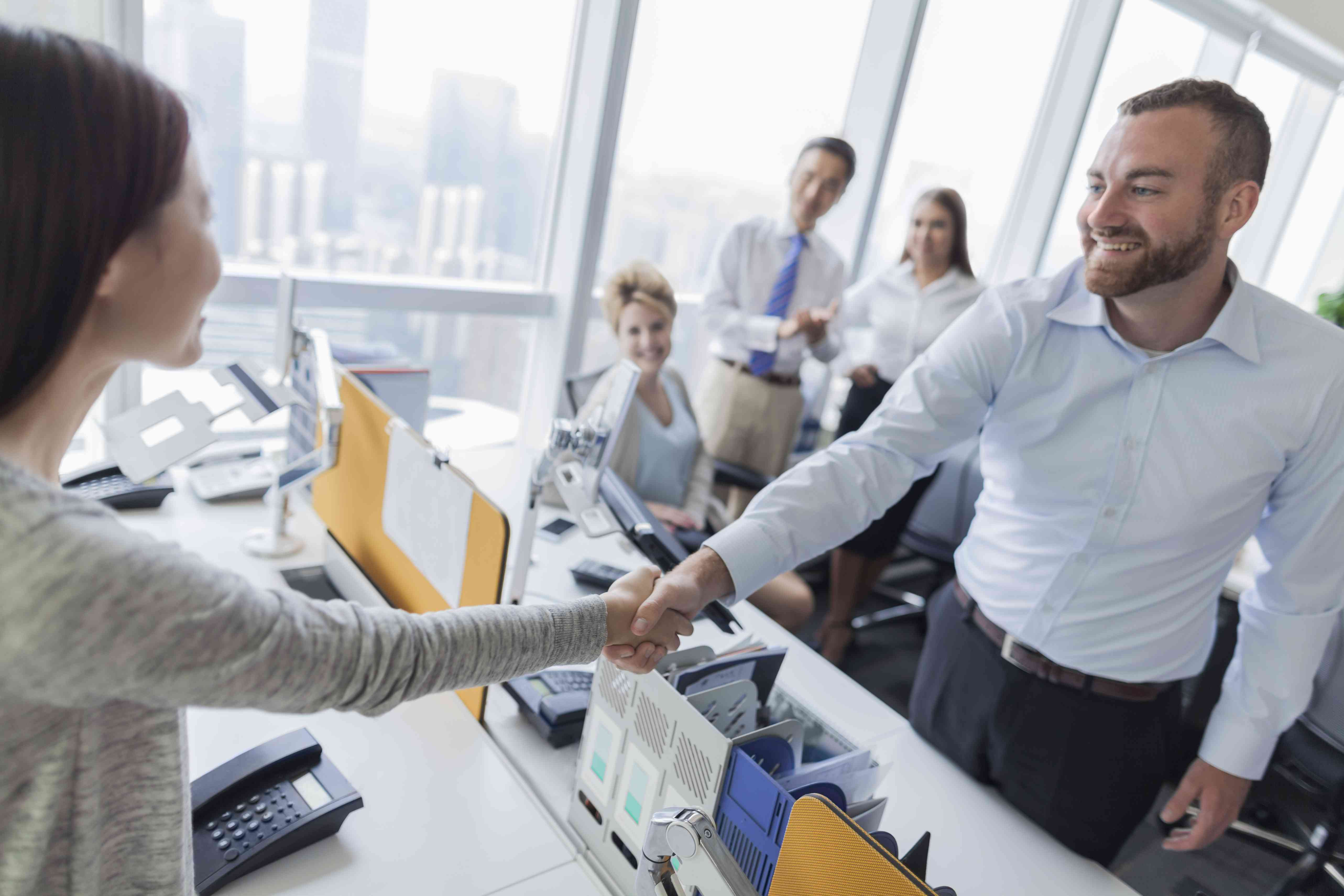 Business handshake in contemporary office