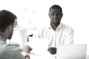 African-american hr manager looking doubtful skeptical about hiring incompetent candidate