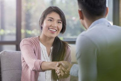 Woman shaking hands in an interview