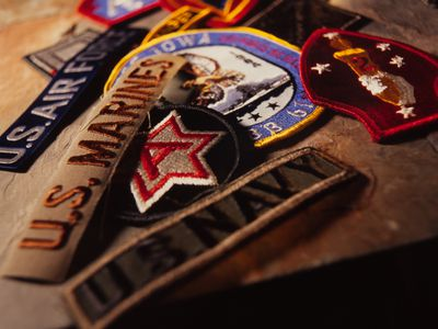 Military patches representing different branches of the service.