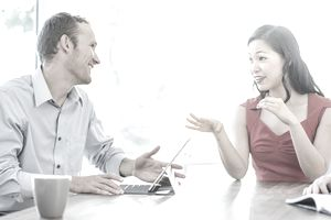 Two people talking in a meeting
