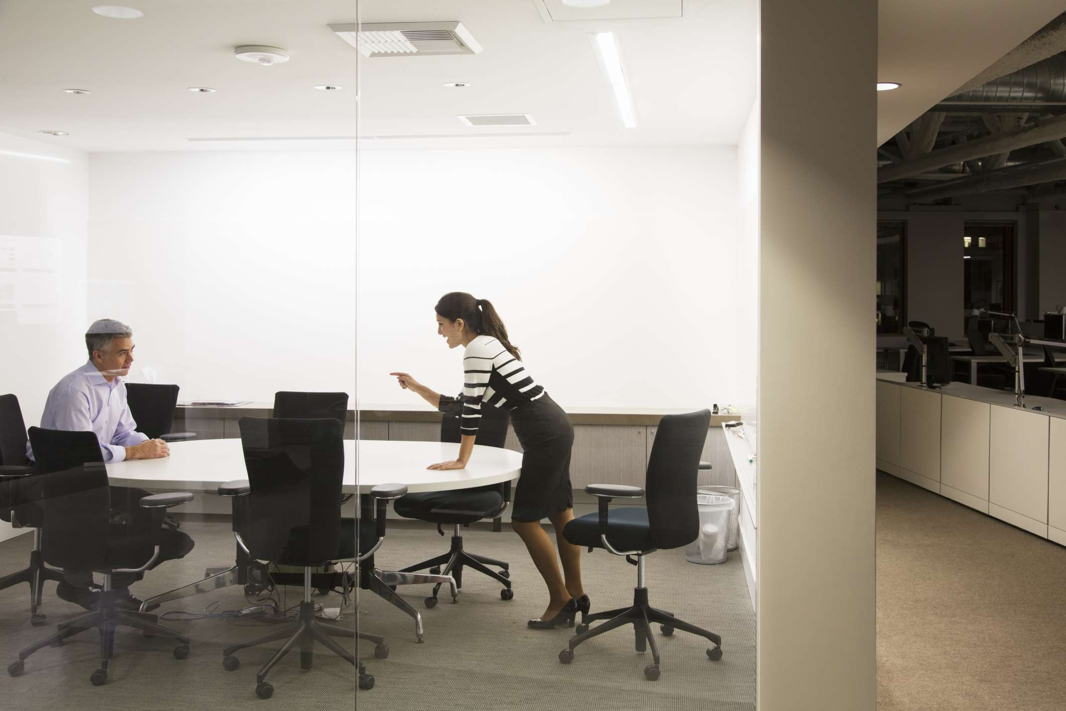 woman yelling at man in conference room