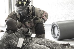 Army Firefighter treating soldier after an event during training.
