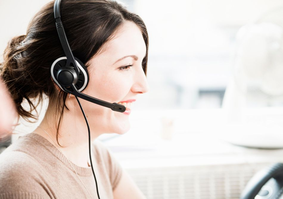 woman on phone headset smiling