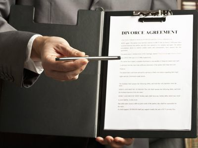Family lawyer handing over pen to sign divorce agreement