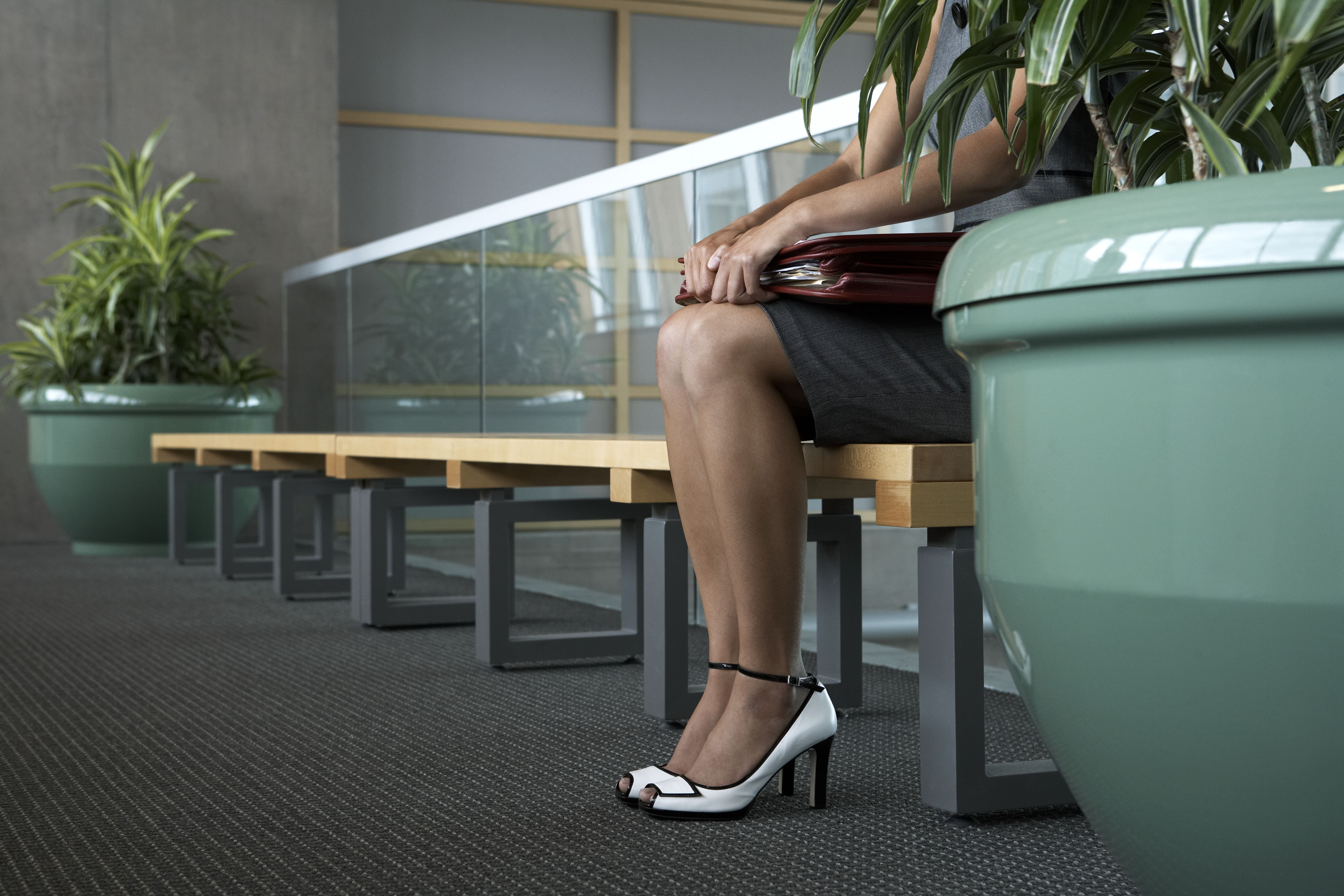 Businesswoman on bench in lobby