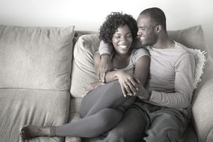 Portrait of mid adult couple sitting on sofa