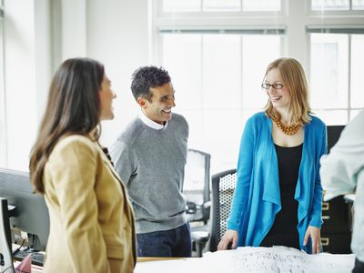 Woman laughing with colleagues