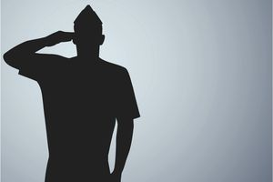 a silhouette of a soldier saluting
