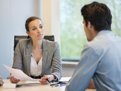 Business executive discussing with her client