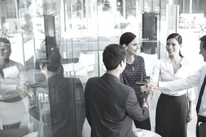A group of business people shaking hands