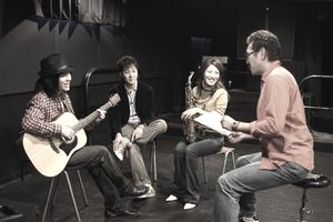 Young people discussing in the recording studio