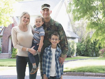 military family in front of house paid for using basic allowance for housing BAH