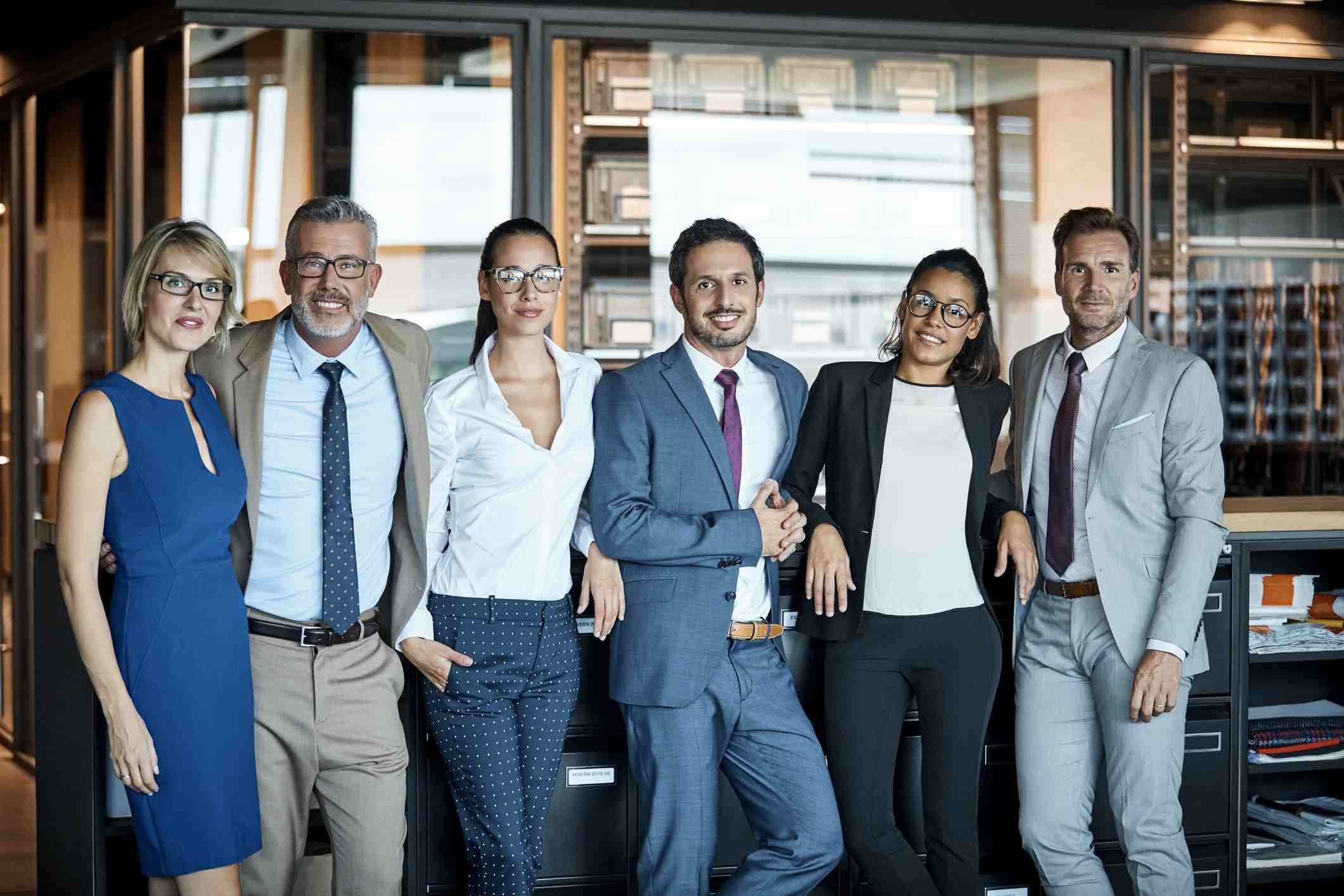Group of co-workers posing in smart-casual business wear