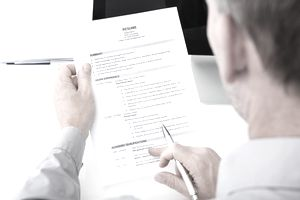 Man reviewing a resume with a summary