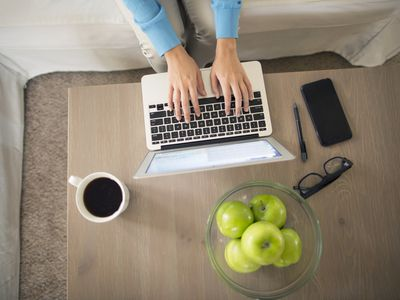top view woman working on laptop