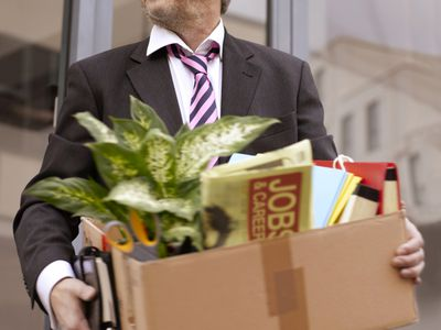 Fired employee with a box of his personal items