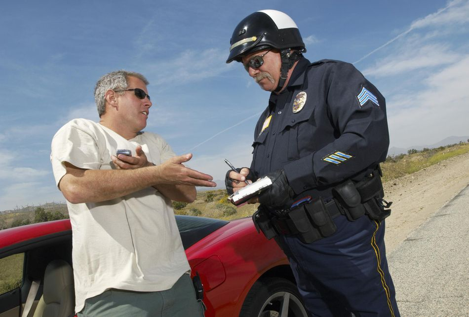 a motorist speaking with a police officer