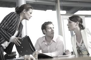 Employees discussing employer monitoring of employee internet use during the work day.
