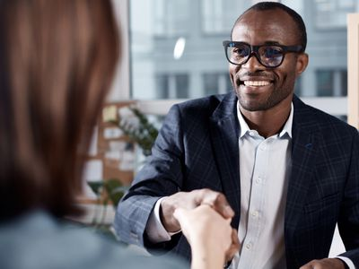 Optimistic qualified man is interviewing lady