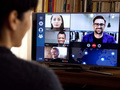 Woman in front of a device screen in video conference for work