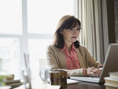 Woman writing a letter of interest on her laptop