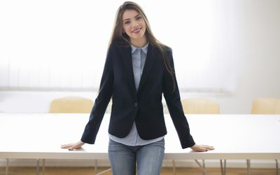 1c40dcb4809e What Business Casual Dress for Work Looks Like on Employees. Business woman  in jeans and a blazer