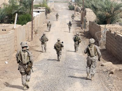 Marine riflemen provide security for combat engineers with Engineer Company, Marine Wing Support Squadron 373, 3rd Marine Aircraft Wing (Forward) while engaging in a route repair mission in Combat Outpost Falcon, Iraq.
