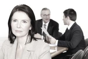 Unhappy woman walks away from a meeting that negatively affected her motivation and morale.