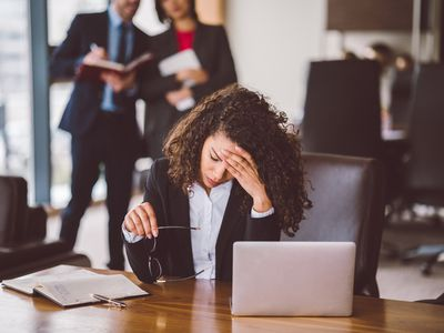 Stressed employee sitting at a desk
