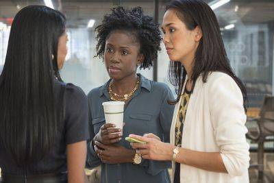 Three Woman, Including an HR Manager, Talk About an Organizational Issue.