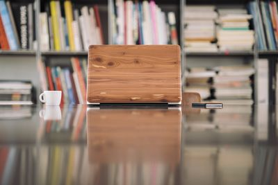Wooden box sitting on a desk in a library
