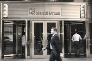 Pedestrians walk past Merrill Lynch offices in New York City