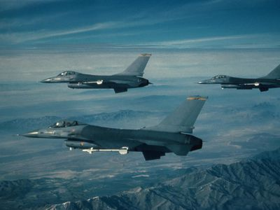 military fighters flying in formation
