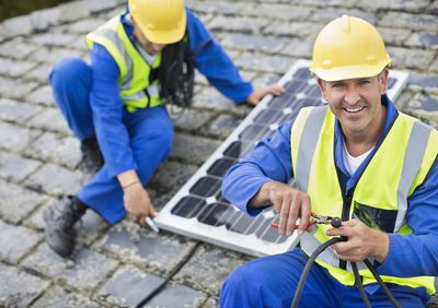 Two solar panel installers