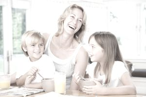 A picture of a mom and her kids laughing