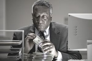 African businessman counting money