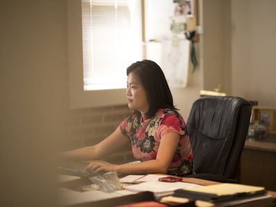 A woman working alone in a home office