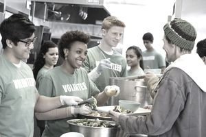 volunteers helping with kitchen service