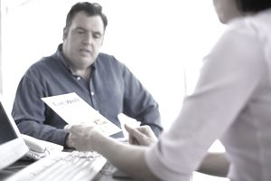 nutritionist giving brochure to overweight male client
