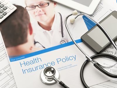 Health Insurance Policy brochure with paperwork.