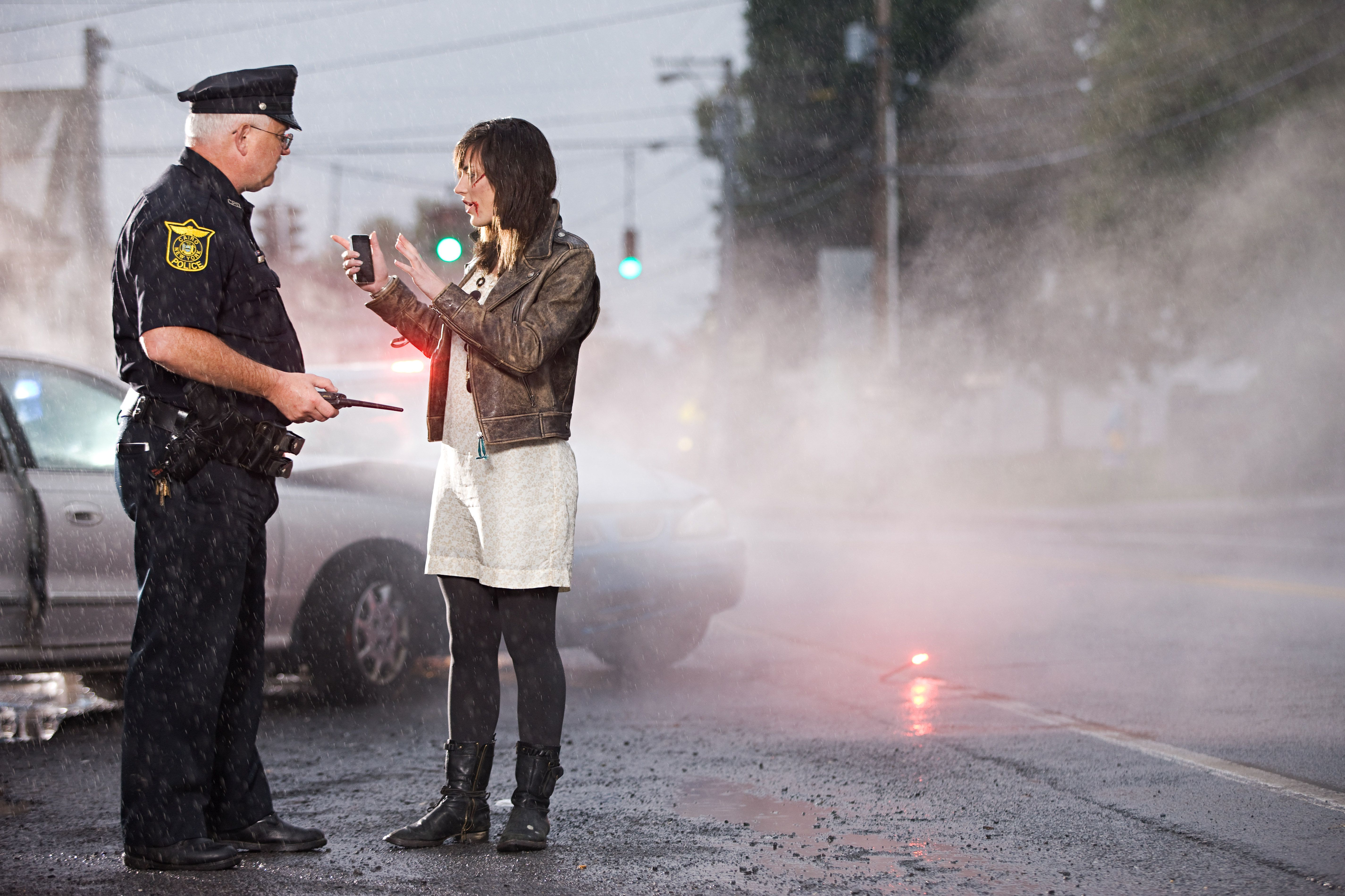 Young woman and police officer at scene of crash