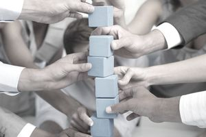Co-workers building with blocks