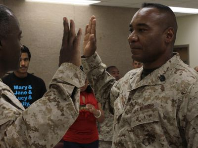 Two men swearing in at a USMC reenlistment ceremony.