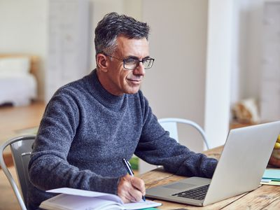 Shot of a mature businessman working from home